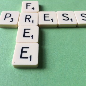 Block letters spell out 'Free press'